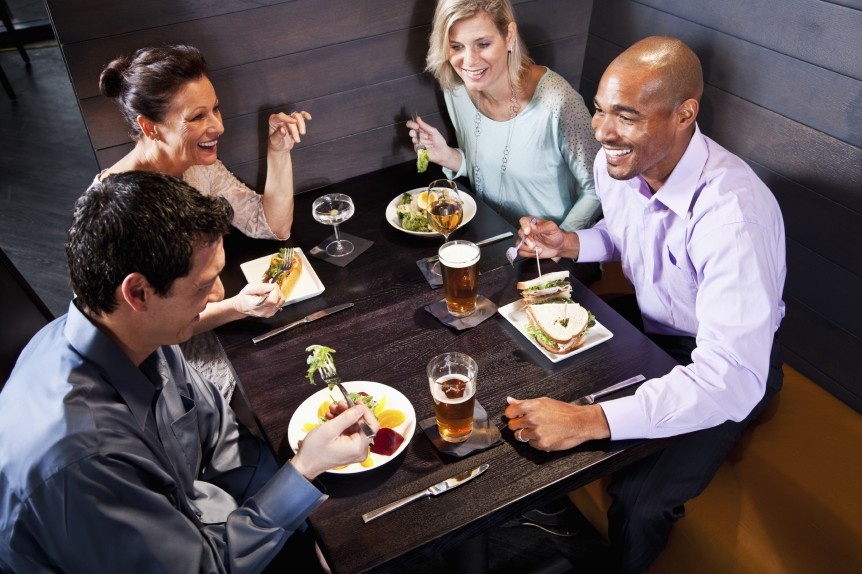 Two couples eating in a restaurant